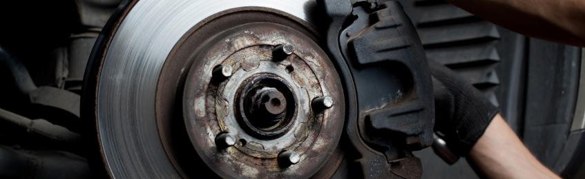 mechanic-servicing-brakes